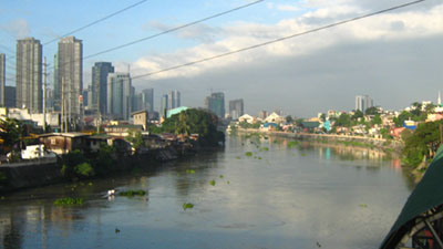 Pasig River with the skyline of Rockwell in the background